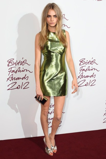 Cara_Delevingne_winner_of_the_Model_of_the_Year_Award_wearing_a_Burberry_metallic_shift_dress_with_Dominic_Jones_jewellery
