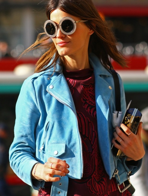 STREET-STYLE-FASHION-WEEK-ROUND-SUNGLASSES-HANNELI-MUSTAPARTA-BLOGGER-EMBELLISHED-OVERSIZED-SUNGLASSES-BLUE-SUEDE-LEATHER-MOTO-JACKET-EMBROIDERED-SWEATER-RINGS-KNUCKLE-RING-CLUTCH-BAG-VOGUE-MAGAZINE